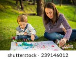 happy mother and son child... | Shutterstock . vector #239146012