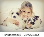 Stock photo child and puppy and kitten and rabbit 239228365