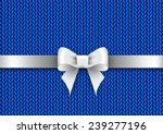 silver satin bow on a blue... | Shutterstock .eps vector #239277196