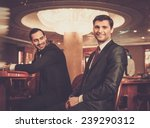 two fashionable men in suits... | Shutterstock . vector #239290312