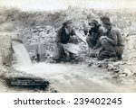 Small photo of Three men, with dog, panning for gold in a stream in the Black Hills of South Dakota in 1889. Old timers, Spriggs, Lamb and Dillon may be die hard survivors from the Gold Rush of 1876.