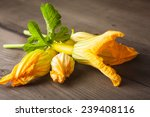 Zucchini Flowers On A Wooden...