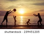 Silhouette Of Happy Family Who...