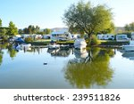 camping site on a lake with... | Shutterstock . vector #239511826