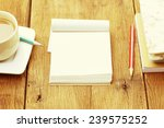 notebook  and coffee on wooden... | Shutterstock . vector #239575252