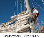 Young Man Working On Sailing...