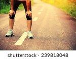 tired woman runner taking a... | Shutterstock . vector #239818048