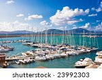 Classic white yachts anchored in the port of Alghero, Sardinia - stock photo