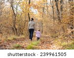 mother and daughter holding... | Shutterstock . vector #239961505