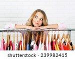 beautiful young woman near rack ... | Shutterstock . vector #239982415