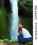 little girl is sitting beside a ... | Shutterstock . vector #23999788