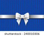 silver satin bow on a blue... | Shutterstock . vector #240010306