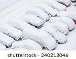 Cars Covered In Snow On A...