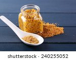 Mustard In Glass Jar And...