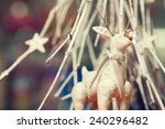 Christmas decoration concept. Vintage toy - christmas deer - with bow on its neck standing over white christmas tree in restaurant. Pastel colors. Retro style. Close up. Indoor shot - stock photo