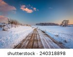 Snow Covered Field Along A Dirt ...