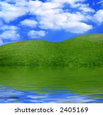 Beautiful summer landscape green grass under blue sky with reflection in water nature scenic - stock photo