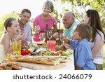 family dining al fresco | Shutterstock . vector #24066079