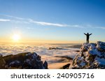 Stock photo hiker celebrating success on top of a mountain in a majestic sunrise 240905716