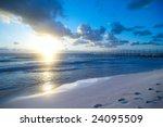Beach Sunrise With Blue Sky