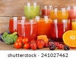 glasses of tasty fresh juice ... | Shutterstock . vector #241027462