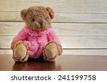 brown bear on wood table  still ... | Shutterstock . vector #241199758