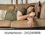 fat guy sleeping on the couch... | Shutterstock . vector #241260808