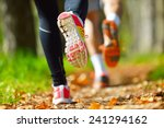 young couple jogging in park at ... | Shutterstock . vector #241294162