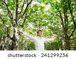 young free man enjoying nature... | Shutterstock . vector #241299256