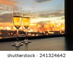 glasses of white wine against... | Shutterstock . vector #241324642