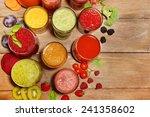 glasses of tasty fresh juice ... | Shutterstock . vector #241358602