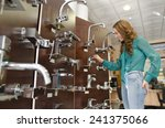 woman at furniture and faucet... | Shutterstock . vector #241375066