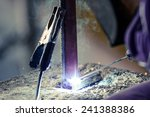 Man Hand Iron Welding At...
