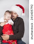 happy dad with baby in festive... | Shutterstock . vector #241405792