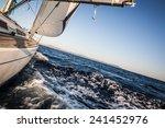 yacht sailing on sea towards... | Shutterstock . vector #241452976