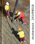 construction workers casting... | Shutterstock . vector #241498018