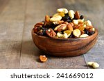 dried fruits and nuts mix in a... | Shutterstock . vector #241669012