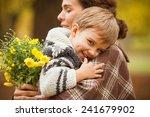 cute little boy in his mother's ...   Shutterstock . vector #241679902