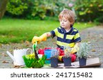 Cute Kid Boy Learning To Plant...