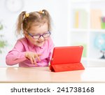 kid with tablet pc in glasses... | Shutterstock . vector #241738168