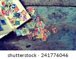 old post stamps on a wooden... | Shutterstock . vector #241776046