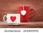 cups with heart shapes over... | Shutterstock . vector #241833592