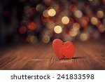 Stock photo close up of two red hearts on old wooden board against defocused lights 241833598