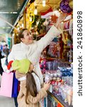 woman with  daughter buying... | Shutterstock . vector #241860898