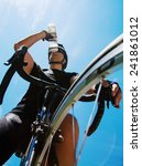 Cyclist Drinking Water Over...
