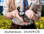 girl scout holding the compass... | Shutterstock . vector #241929178