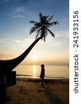 silhouette life at sunset beach. | Shutterstock . vector #241933156
