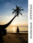 silhouette life at sunset beach. | Shutterstock . vector #241933162