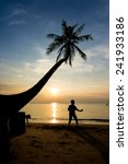 silhouette life at sunset beach. | Shutterstock . vector #241933186