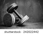 old  dumbbells  bw photo | Shutterstock . vector #242022442